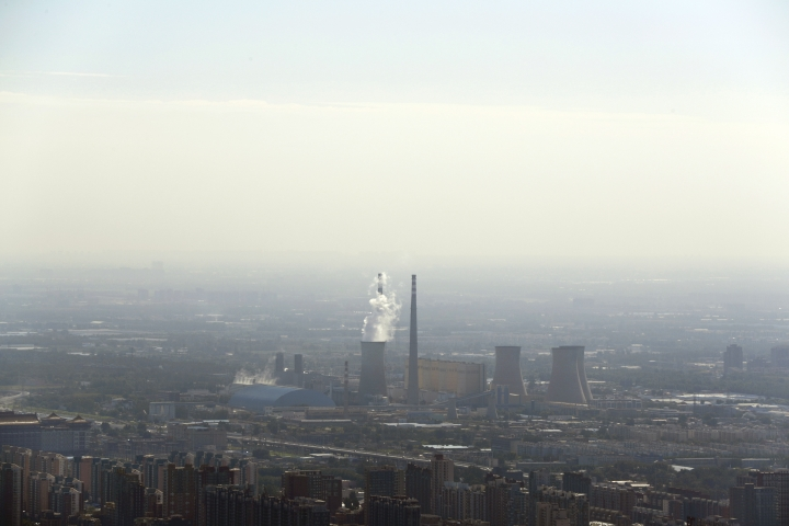 White smoke billows from a coal-fired power plant near the residential buildings in Beijing, Saturday, Sept. 3, 2016. China announced on Saturday that it has ratified the emissions-cutting agreement reached last year in Paris, giving a big boost to efforts to bring the accord into effect by the end of this year. (AP Photo/Andy Wong)