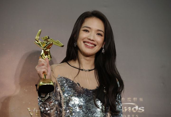 FILE - In this March 17, 2016 file photo, Taiwanese actress Shu Qi poses after winning the Best Actress awards of the Asian Film Awards in Macau, China. Shu surprised fans and the public by announcing Saturday, Sept. 3, that she has married Hong Kong actor-director Stephen Fung. Rumors swirled for years that the two were dating, but neither had confirmed their relationship. (AP Photo/Kin Cheung, File)