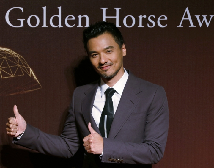 """FILE - In this Nov. 22, 2015 file photo, Hong Kong actor-director Stephen Fung poses on the red carpet at the 51st Golden Horse Awards in Taipei, Taiwan. """"The Assassin"""" star Shu Qi surprised fans and the public by announcing Saturday, Sept. 3, 2016, that she has married Fung. Rumors swirled for years that the two were dating, but neither had confirmed their relationship. (AP Photo/Wally Santana, File)"""