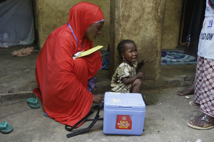 In this photo taken on Saturday, Aug. 28, 2016, a child cries after she was administered with a polio vaccine during a house to house vaccination exercise in Maiduguri, Nigeria. An emergency polio vaccination campaign aimed at reaching 25 million children this year has begun in parts of Nigeria newly freed from Boko Haram Islamic extremists, with fears that many more cases of the crippling disease are likely to be found. (AP Photo/Sunday Alamba)