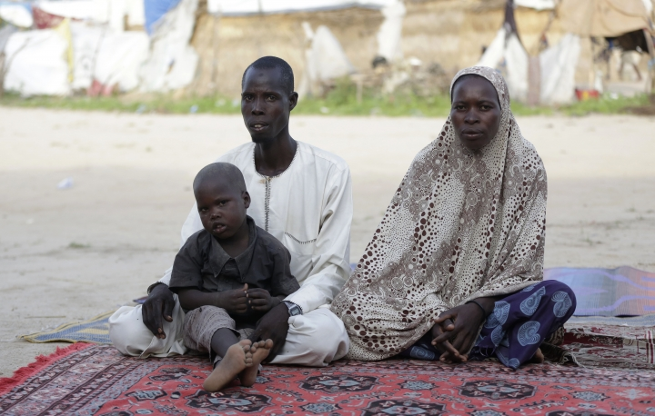In this photo taken on Tuesday, Aug. 30, 2016, Gambo Bukar, left and Palmata Bukar, right, parents of Idrisa Gambo, a recent polio case victim, sit during an interview at Muna camp for people displaced by Islamist Extremist in Maiduguri, Nigeria, Tuesday Aug. 30, 2016. An emergency polio vaccination campaign aimed at reaching 25 million children this year has begun in parts of Nigeria newly freed from Boko Haram Islamic extremists, with fears that many more cases of the crippling disease are likely to be found. (AP Photo/Sunday Alamba)