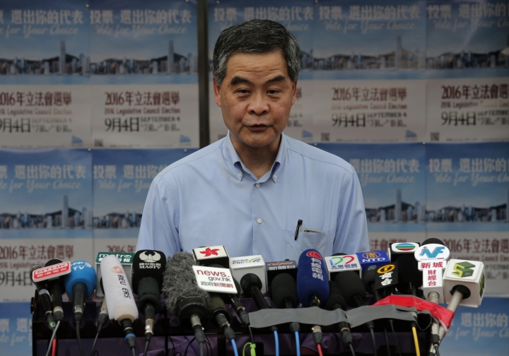 Hong Kong Chief Executive Leung Chun-ying talks to reporters after voting at a polling station for the legislative council election Sunday, Sept. 4, 2016. Polls opened in Hong Kong Sunday for the specially administered Chinese city's most crucial election since the handover from Britain in 1997. The vote for lawmakers in the Legislative Council is also the first since 2014 pro-democracy street protests rocked the Asian financial hub. (AP Photo/Vincent Yu)