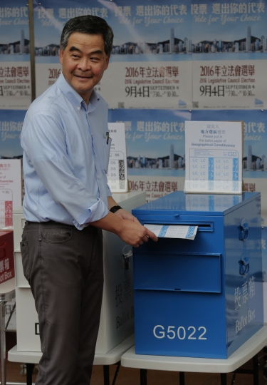 Hong Kong Chief Executive Leung Chun-ying votes at a polling station for the legislative council election Sunday, Sept. 4, 2016. Polls opened in Hong Kong Sunday for the specially administered Chinese city's most crucial election since the handover from Britain in 1997. The vote for lawmakers in the Legislative Council is also the first since 2014 pro-democracy street protests rocked the Asian financial hub. (AP Photo/Vincent Yu)
