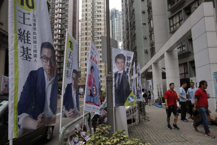 Election banners are displayed near a polling station for the legislative council election Sunday, Sept. 4, 2016. Polls opened in Hong Kong Sunday for the specially administered Chinese city's most crucial election since the handover from Britain in 1997. The vote for lawmakers in the Legislative Council is also the first since 2014 pro-democracy street protests rocked the Asian financial hub. (AP Photo/Vincent Yu)
