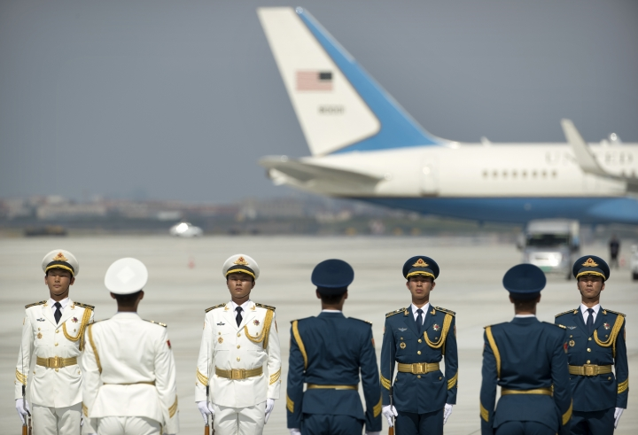 Members of a Chinese honor guard line up near a U.S. Air Force plane before the arrival of U.S. President Barack Obama at the Hangzhou Xiaoshan International Airport, Saturday, Sept. 3, 2016, in Hangzhou, China, to attend the G-20 summit. (AP Photo/Mark Schiefelbein)