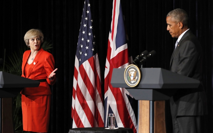 U.S. President Barack Obama and British Prime Minister Theresa May talk to media after a bilateral meeting in Hangzhou in eastern China's Zhejiang province, Sunday, Sept. 4, 2016, alongside the G20. (AP Photo/Carolyn Kaster)