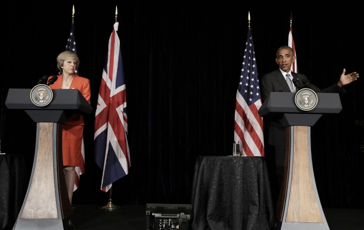 U.S. President Barack Obama and British Prime Minister Theresa May talk to media after their bilateral meeting in Hangzhou in eastern China's Zhejiang province, Sunday, Sept. 4, 2016, alongside the G20. (AP Photo/Carolyn Kaster)
