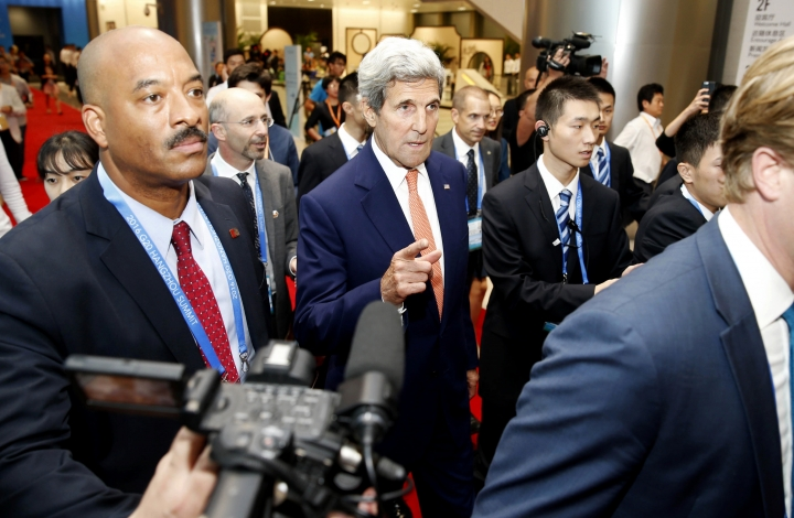U.S. Secretary of State John Kerry, center, walks through the Hangzhou International Expo Center during the G20 Summit in Hangzhou in eastern China's Zhejiang Province, Sunday, Sept. 4, 2016. Kerry and Russian Foreign Minister Sergey Lavrov were trying to hash out a deal Sunday to end years of brutal fighting between Syria's Russian-backed government and U.S.-supported rebels. (Chinatopix via AP)