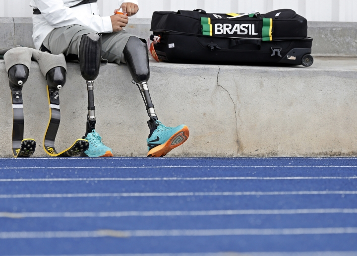 In this July 22, 2016 photo, Brazilian athlete Alan Fonteles, who competes in category T44 sprint events, prepares to train for the upcoming Paralympic Games in Sao Paulo, Brazil. Only a last-minute Brazilian government bailout has helped save the event from a shortfall in the local, privately funded operating budget. (AP Photo/Andre Penner)