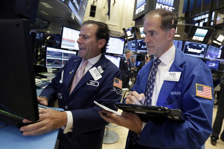 Specialist Michael Pistillo, left, and trader Mark Puetzer work on the floor of the New York Stock Exchange, Tuesday, Sept. 6, 2016. U.S. stocks indexes are mostly higher in early trading as traders look over the details of several corporate deals. (AP Photo/Richard Drew)