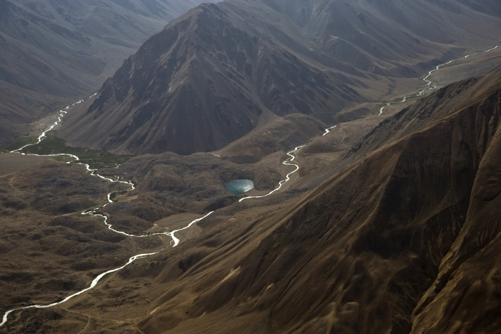 This Aug. 15, 2016 photo, shows an ariel view of the snow-capped Pamir mountains in the Wakhan district of Badakhshan province, far northeastern Afghanistan. The Wakhan corridor, which has been named Afghanistan's second national park, is the country's most -- perhaps only -- peaceful region. But it is so poor, even for Afghanistan, that people borrow food and children go barefoot during the long, harsh winters. (AP Photo/Massoud Hossaini)