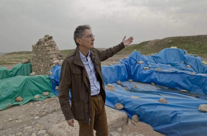 FILE - In this Saturday, Nov. 15, 2014, file picture, Nicolo Marchetti, a professor of archaeology and art history of the Ancient Near East at the University of Bologna gestures near the ruins of the expedition house of Lawrence of Arabia, who worked at Karkemish between 1911 and 1914, at an archaeologic site outside Karkemish, Turkey, meters away from the Turkey-Syria border and the Syrian city of Jarablous. Despite Syria's civil war, archaeologists on the Turkish side of border-straddling Karkemish unearthed sculptures, mosaics and other artifacts in relative safety although sporadic gunfire and shelling was occasionally audible from the Syrian side. Now they plan to open the remains of the strategic city from the Hittite era to the public next year, despite the proximity of conflict in neighboring Syria. (AP Photo/Vadim Ghirda, File)