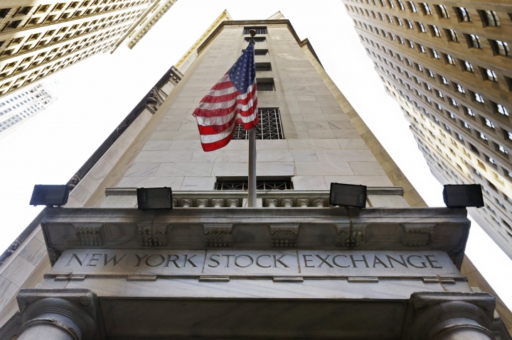 FILE - In this Friday, Nov. 13, 2015, file photo, the American flag flies above the Wall Street entrance to the New York Stock Exchange. U.S. stock indexes edged lower in morning trading Wednesday, Sept. 7, 2016, weighed down by a slide in supermarket operators and other consumer-focused companies. Materials stocks also were among the big decliners. A sharp drop in hiring in August 2016 overshadowed a report Wednesday showing a pickup in job openings in July. (AP Photo/Richard Drew, File)