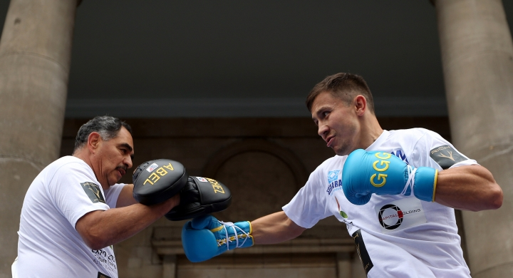 Gennady Golovkin of Kazakhstan, right, fights during a workout in Covent Garden, London, Tuesday Sept. 6, 2016. Golovkin will fight Britain's Kell Brook in London on Saturday Sept. 10. (Steve Paston/PA via AP)
