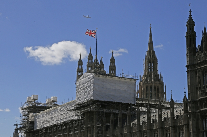 View of the Houses of Parliament with scaffolding around a section of the building in London, Thursday, Sept. 8, 2016. A committee charged with stopping Britain's creaky, leaky Parliament from falling down is set to say whether lawmakers will have to move out for several years so repair work can be done. The Joint Committee on the Palace of Westminster has been studying options for the 19th-century complex, which needs work to repair collapsing roofs, crumbling walls and leaking pipes, and to remove asbestos. (AP Photo/Frank Augstein)