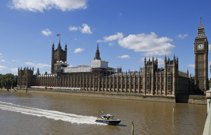 General view of the Houses of Parliament with scaffolding erected in the centre in London, Thursday, Sept. 8, 2016. A committee charged with stopping Britain's creaky, leaky Parliament from falling down is set to say whether lawmakers will have to move out for several years so repair work can be done. The Joint Committee on the Palace of Westminster has been studying options for the 19th-century complex, which needs work to repair collapsing roofs, crumbling walls and leaking pipes, and to remove asbestos. (AP Photo/Frank Augstein)