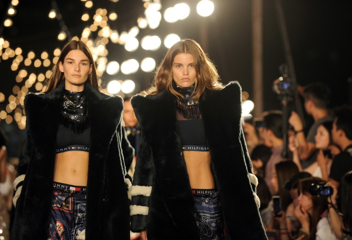 Fashion from the Tommy Hilfiger Fall 2016 collection and the TommyXGigi capsule are modeled during Fashion Week in New York, Friday, Sept. 9, 2016. (AP Photo/Diane Bondareff)