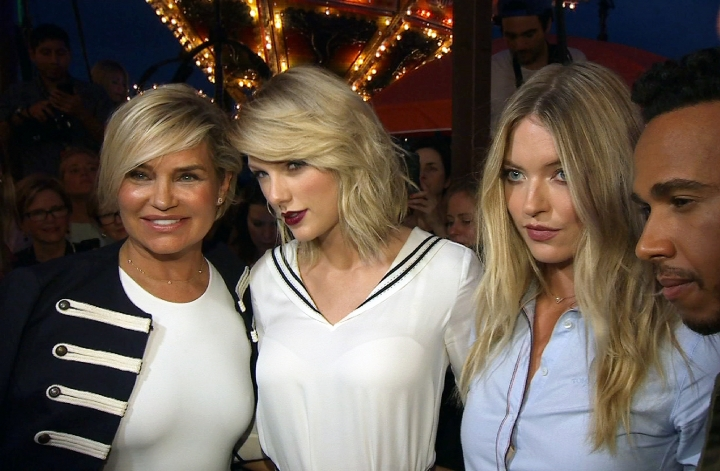 This image taken from video shows, from left, TV personality Yolanda Hadid, singer Taylor Swift, model Martha Hunt and Formula One racer Lewis Hamilton at the the Tommy Hilfiger Fall 2016 collection at Fashion Week in New York, Friday, Sept. 9, 2016. (AP Photo/Zoran Drakulic)
