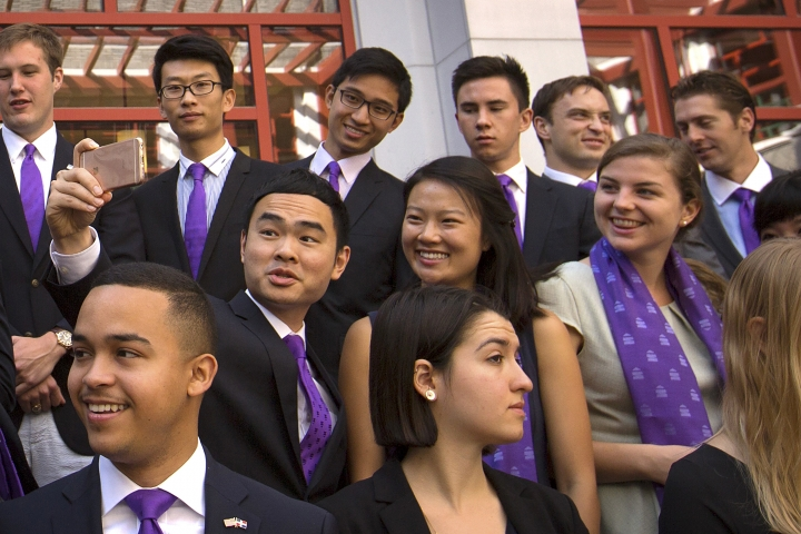 Members of the Schwarzman Scholars take a selfie as they line up for a group photo before a ceremony to officially open the scholar program at Tsinghua University in Beijing, Saturday, Sept. 10, 2016. A new scholarship program intended to rival the prestigious Rhodes Scholarships and build understanding between China and the world opened its doors at Beijing's prestigious Tsinghua University on Saturday. (AP Photo/Mark Schiefelbein)