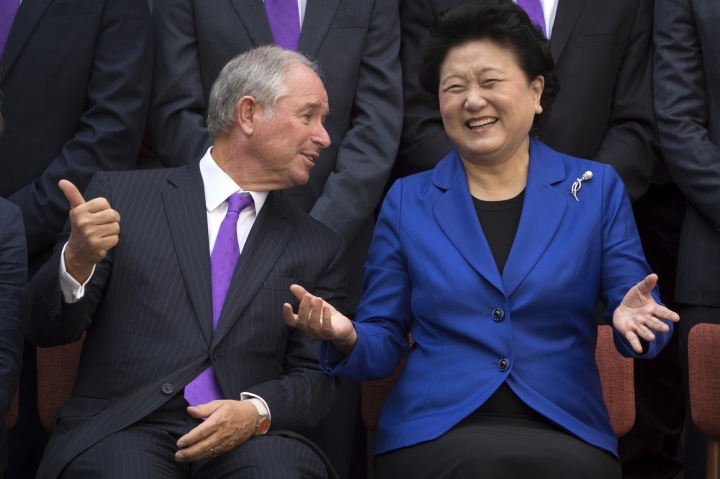 Stephen Schwarzman, left, founder and CEO of the Blackstone Group, talks with China's Vice Premier Liu Yandong during a group photo at Tsinghua University in Beijing, Saturday, Sept. 10, 2016. A new scholarship program intended to rival the prestigious Rhodes Scholarships and build understanding between China and the world opened its doors at Beijing's prestigious Tsinghua University on Saturday. (AP Photo/Mark Schiefelbein)