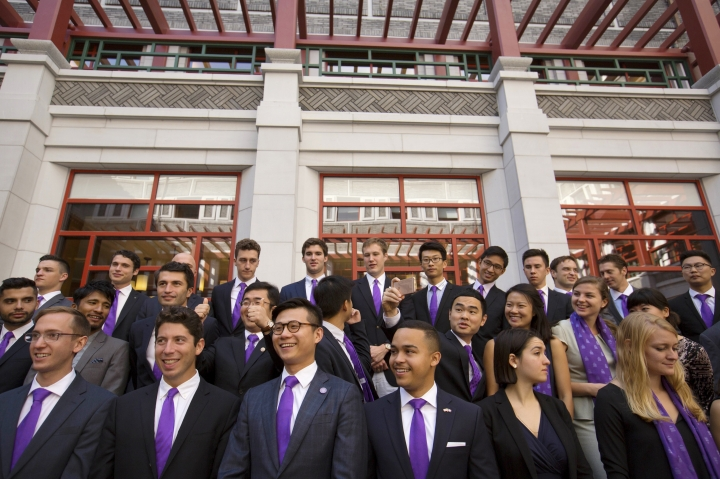 Members of the Schwarzman Scholars line up for a group photo before a ceremony to officially open the scholar program at Tsinghua University in Beijing, Saturday, Sept. 10, 2016. A new scholarship program intended to rival the prestigious Rhodes Scholarships and build understanding between China and the world opened its doors at Beijing's prestigious Tsinghua University on Saturday. (AP Photo/Mark Schiefelbein)