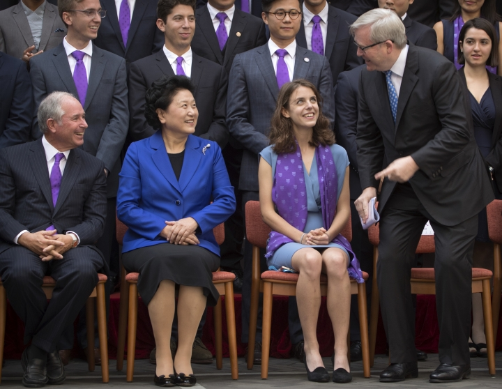 Former Australian Prime Minister Kevin Rudd, right, talks with Stephen Schwarzman, left, founder and CEO of the Blackstone Group, and Chinese Vice Premier Liu Yandong, second from left, as he arrives for a group photo at Tsinghua University in Beijing, Saturday, Sept. 10, 2016. A new scholarship program intended to rival the prestigious Rhodes Scholarships and build understanding between China and the world opened its doors at Beijing's prestigious Tsinghua University on Saturday. (AP Photo/Mark Schiefelbein)