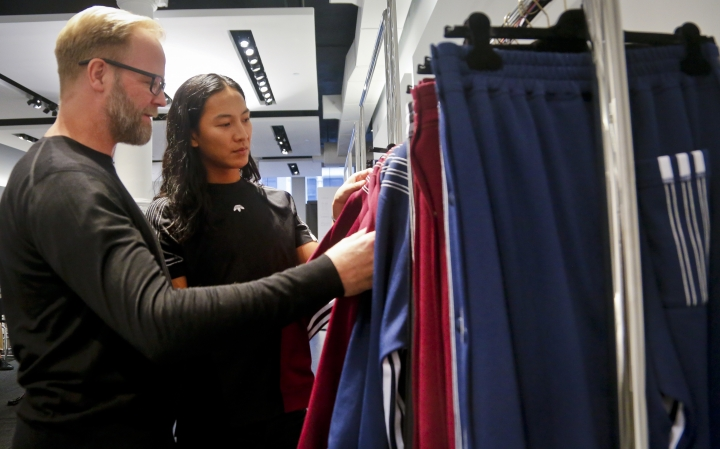 "Fashion designer Alexander Wang, right, and Adidas creative director Nic Galway discuss the collection ""adidas Originals by Alexander Wang,"" Tuesday, Sept. 6, 2016, in New York. (AP Photo/Bebeto Matthews)"