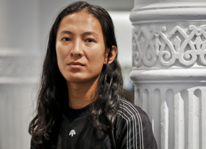 """Fashion designer Alexander Wang poses in his studio Tuesday, Sept. 6, 2016, in New York. Wang will unveil his latest collection during Fashion Week, including his collaboration with Adidas-- """"adidas Originals by Alexander Wang,"""" (AP Photo/Bebeto Matthews)"""
