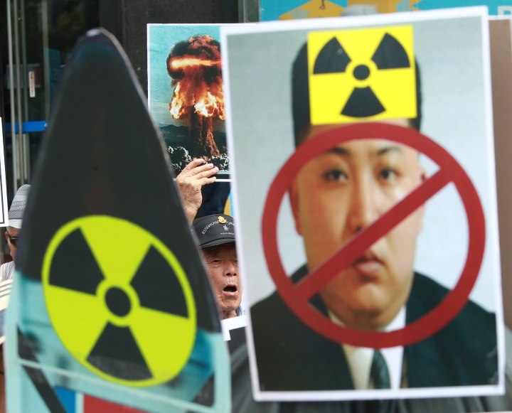 FILE - In this file photo taken on Saturday, Sept. 10, 2016, a South Korean protester shouts slogans during a rally denouncing North Korea's latest nuclear test in Seoul, South Korea, Saturday, Sept. 10, 2016. On Monday, China said the United States has inflamed the conflict on the Korean Peninsula and must carry the burden of ending it in the wake of North Korea's fifth nuclear test. (AP Photo/Ahn Young-joon)
