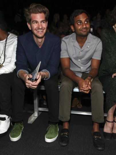 Andrew Garfield, left, and Aziz Ansari, right, attend the Opening Ceremony fashion show during NYFW Spring/Summer 2017 at the Javits Center on Sunday, Sept. 11, 2016, in New York. (Photo by Andy Kropa/Invision/AP)
