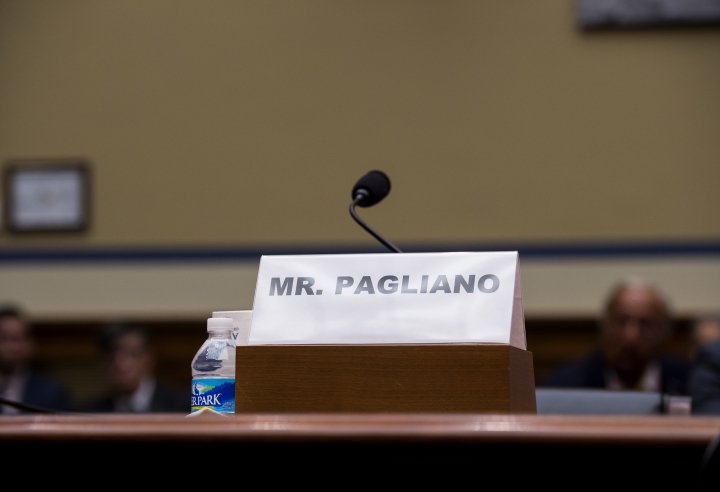The name plate for witness Bryan Pagliano, former senior adviser, Information Resource Management, State Department, who did not appear, sits on the witness table on Capitol Hill in Washington, Tuesday, Sept. 13, 2016, during a hearing of the House Oversight and Government Reform Committee on 'Examining Preservation of State Department Records.' (AP Photo/Molly Riley)