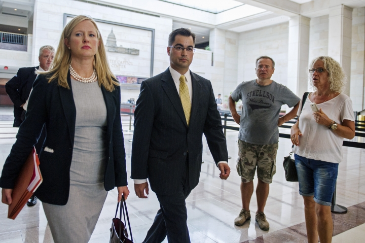 FILE - In this Sept. 10, 2015 file photo, Bryan Pagliano, center, a former State Department employee who helped set up and maintain a private email server used by Hillary Rodham Clinton, departs Capitol Hill in Washington. House Republicans on Tuesday, Sept. 13, 2016, continue their attacks on former Secretary of State Clinton's emails by calling the tech expert who set up her private server and representatives from the company that maintained the system to testify at a congressional hearing. Pagliano, a former information resource management adviser at the State Department, is scheduled to appear Tuesday before the Oversight and Government Reform Committee. (AP Photo/Cliff Owen, Lee, File)