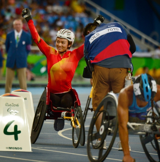Zou Lihong, of China waves to the Olympic Stadium crowd after her bronze-medal finish in the women's 400 meters at the 2016 Paralympic Games at Olympic Stadium in Rio de Janeiro. (Shannon Ryan/Penn State University via AP)