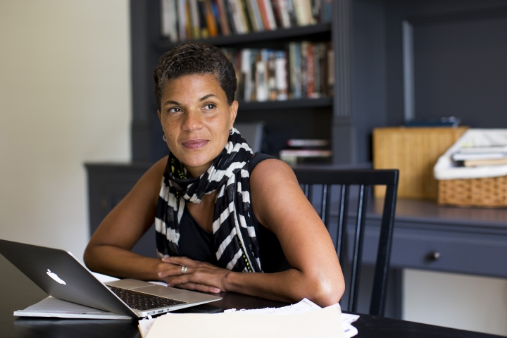 In this Friday, Sept. 9, 2016 photo provided by Megan Leigh Barnard, Ohio State University law professor, civil rights advocate and writer Michelle Alexander poses for a photograph in her home office in New Albany, Ohio. The Heinz Family Foundation announced winners of the Heinz Awards on Wednesday, Sept. 14, 2016, naming legal scholar Alexander and others as winners. (Megan Leigh Barnard via AP)