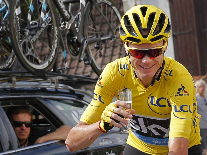 "FILE - This is a Sunday, July 24, 2016 file photo of Britain's Chris Froome, wearing the overall leader's yellow jersey, celebrates with a glass of champagne during the twenty-first stage of the Tour de France in Paris. Three-time Tour de France winner Chris Froome siad Thursday Sept. 15, 2016, has ""no issue"" with his medical data being leaked, in an alleged criminal attack by Russian hackers on a World Anti-Doping Agency database. (AP Photo/Christophe Ena, File)"