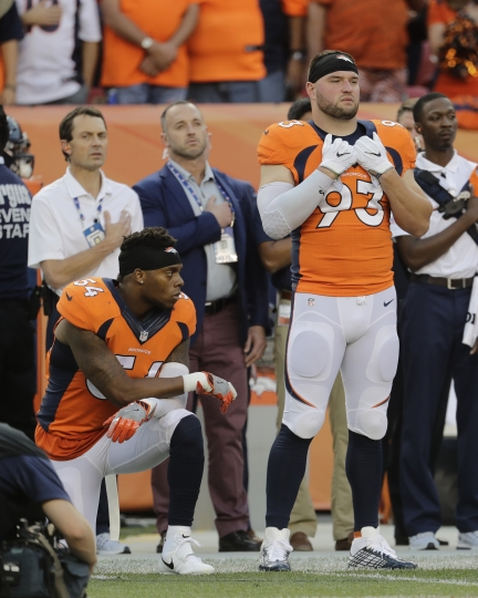 FILE - In this Thursday, Sept. 8, 2016, file photo, Denver Broncos inside linebacker Brandon Marshall (54) kneels on the sideline during the national anthem before an NFL football game against the Carolina Panthers in Denver. The dozen NFL players who have joined Kaepernick's protest of social injustices by kneeling or raising a fist during the national anthem have faced vitriolic, sometimes racist reactions on social media and at least one has lost endorsements. None are deterred by the backlash. (AP Photo/Joe Mahoney, File)