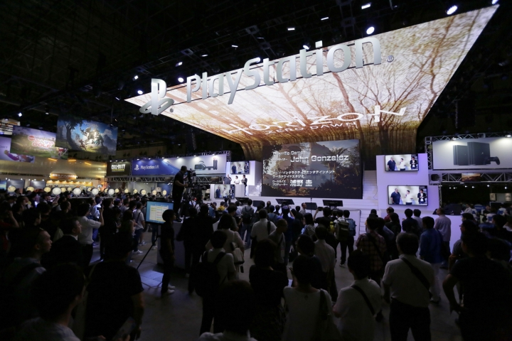 Visitors gather at Sony's PlayStation booth at the Tokyo Game Show in Makuhari, near Tokyo, Thursday, Sept. 15, 2016. Virtual reality has arrived for real at the Tokyo Game Show, one of the world's biggest exhibitions for the latest in fun and games. (AP Photo/Eugene Hoshiko)