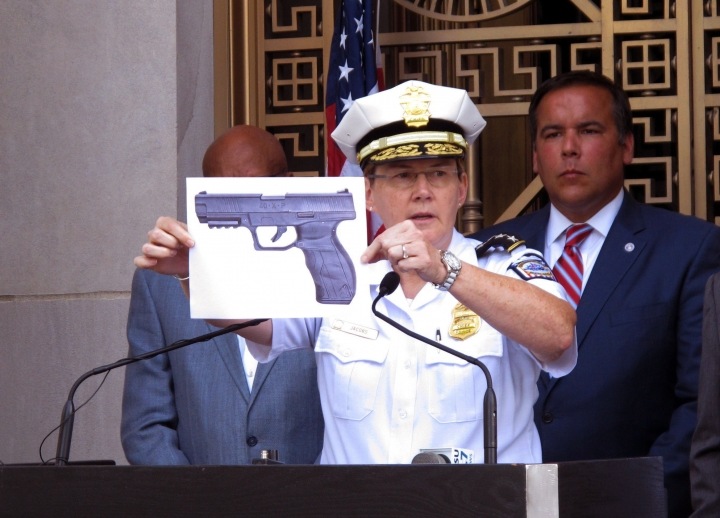 CORRECTS NAME FROM TYREE KING TO TYRE KING -Columbus Police Chief Kim Jacobs holds up a photo showing the type of BB gun that police say a 13-year-old boy pulled from his waistband just before he was shot and killed by police investigating an armed robbery report, on Thursday, Sept. 15, 2016 in Columbus, Ohio. Police say the boy, Tyre King, died at a hospital after the Wednesday evening shooting. (AP Photo/Andrew Welsh-Huggins)