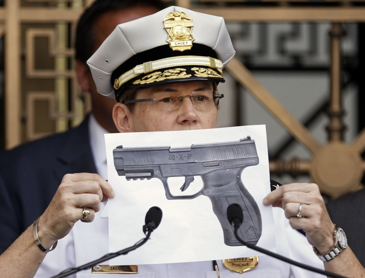 CORRECTS NAME FROM TYREE KING TO TYRE KING - Columbus Police Chief Kim Jacobs holds up a photo showing the type of BB gun that police say a 13-year-old boy pulled from his waistband just before he was shot and killed by police investigating an armed robbery report, on Thursday, Sept. 15, 2016 in Columbus, Ohio. Police say the boy, Tyre King, died at a hospital after the Wednesday evening shooting. (Fred Squillante/The Columbus Dispatch via AP)