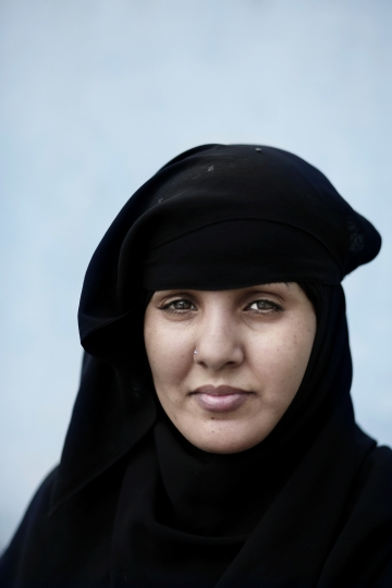In this Friday, Sept. 9, 2016 photo, Fatma Abdullah from Yemen poses for a portrait on Noor Mountain, where Prophet Muhammad received his first revelation from God to preach Islam, on the outskirts of Mecca, Saudi Arabia. Abdullah, who left Sanaa a year ago due to the war, says she misses her home country but is happy to be living near Noor Mountain, a scared site, which brings her peace with her family. (AP Photo/Nariman El-Mofty)