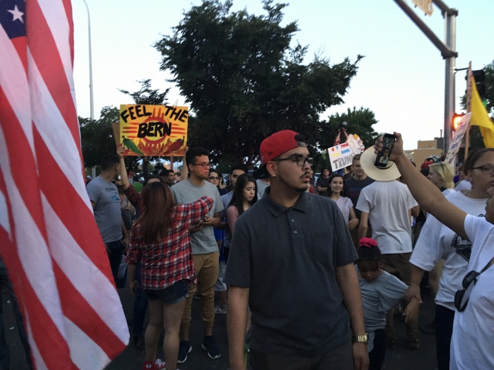 In this May 24, 2016 file photo, Hispanic demonstrators in Albuquerque wave American flags during an anti-Donald Trump protest that later turned violent. San Francisco 49ers quarterback Colin Kaepernick recent refusal to stand for the National Anthem revealed deep differences in the way Americans of all stripes view patriotic symbols in a country founded on the freedom to protest. (AP Photo/Russell Contreras)
