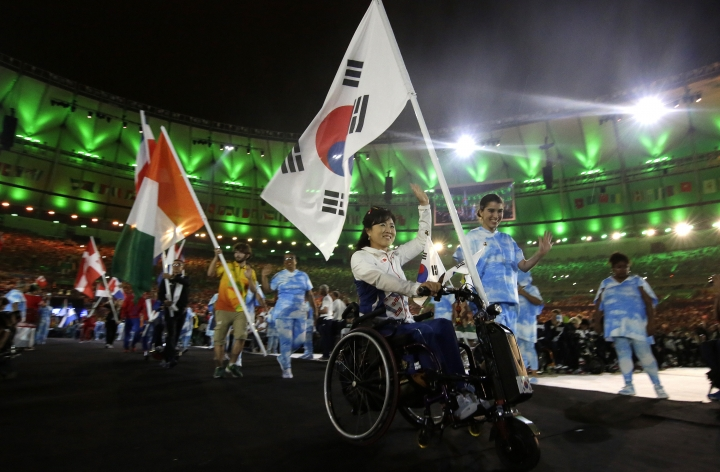 A South Korean athlete brings in their flag during the closing ceremony of the Rio 2016 Paralympic Games at the Maracana Stadium in Rio de Janeiro, Brazil, Sunday, Sept. 18, 2016. (AP Photo/Leo Correa)