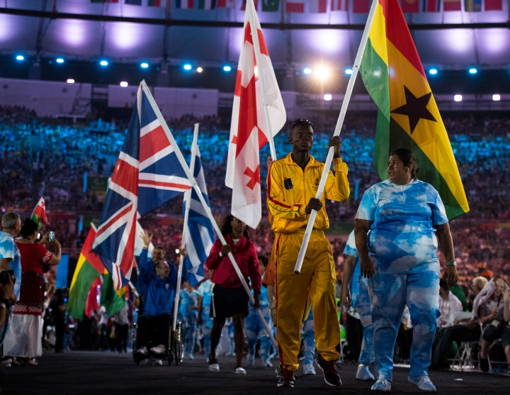 In this photo released by the IOC, flag bearer Yusif Amady, representing Ghana, carries his country's flag during the flag parade during the closing ceremony of the Rio 2016 Paralympic Games at the Maracan' Stadium in Rio de Janeiro, Brazil , Sunday, Sept. 18, 2016. (Thomas Lovelock/OIS, IOC via AP)