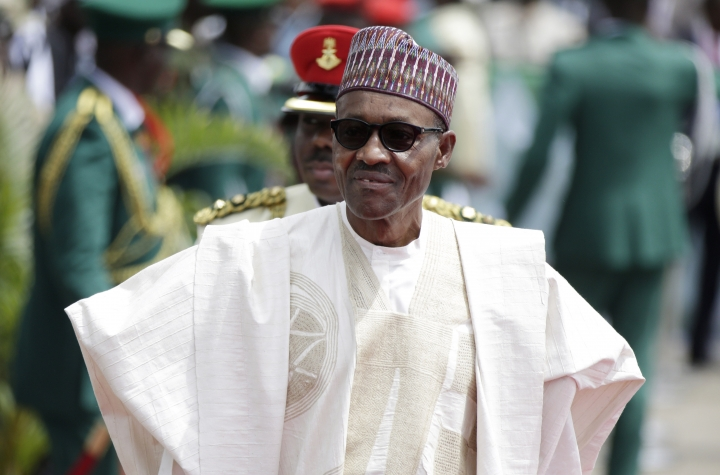 FILE- In this file photo taken Friday, May 29, 2015, Nigerian President elect, Muhammadu Buhari, arrives for his Inauguration at the eagle square in Abuja, Nigeria. The Boko Haram extremist group has finally been crushed — driven from its last forest enclave with fighters on the run and no place to hide, Nigeria's president declared Saturday, Dec. 24, 2016. (AP Photo/Sunday Alamba, File)