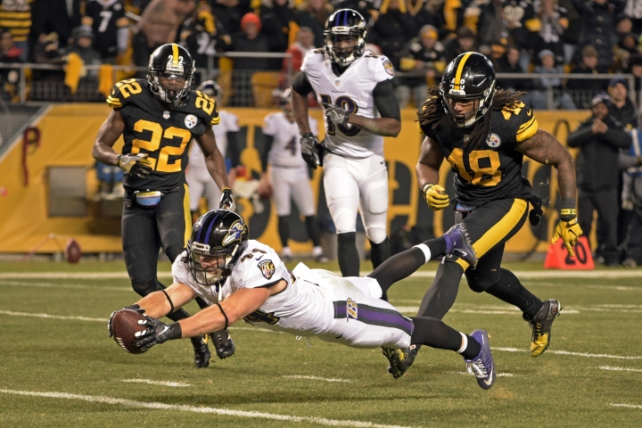 Baltimore Ravens fullback Kyle Juszczyk (44) dives into the end zone for a touchdown during the second half of an NFL football game against the Pittsburgh Steelers in Pittsburgh, Sunday, Dec. 25, 2016. (AP Photo/Fred Vuich)