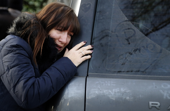 A woman cries outside the home of British musician George Michael in London, Tuesday, Dec. 27, 2016. George Michael, who rocketed to stardom with WHAM! and went on to enjoy a long and celebrated solo career lined with controversies, has died, his publicist said Sunday. He was 53.(AP Photo/Frank Augstein)
