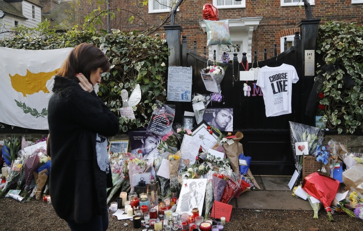 People mourn outside the home of British musician George Michael in London, Tuesday, Dec. 27, 2016. George Michael, who rocketed to stardom with WHAM! and went on to enjoy a long and celebrated solo career lined with controversies, has died, his publicist said Sunday. He was 53.(AP Photo/Frank Augstein)