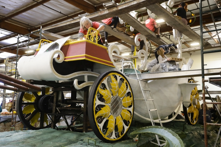 A group of volunteers work on a float ahead of next week's 128th Rose Parade Wednesday, Dec. 28, 2016, in Irwindale, Calif. (AP Photo/Jae C. Hong)