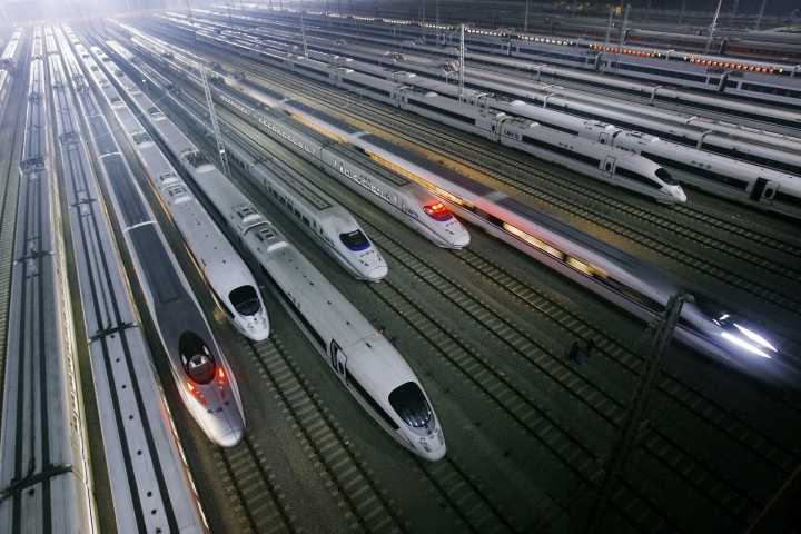 FILE - In this Wednesday, Jan. 11, 2012 file photo, China's CRH high-speed trains sit on tracks at a maintenance base in Wuhan, in central China's Hubei province. The Chinese government is planning to expand the country's high-speed rail network to 30,000 kilometers (18,600 miles) by 2020, part of public infrastructure spending aimed at shoring up economic growth. (AP Photo, File)