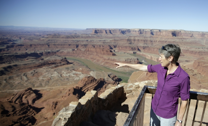 """FILE - This July 14, 2016, file photo, U.S. Interior Secretary Sally Jewell looks from Dead Horse Point, near Moab, Utah, during a tour to meet with proponents and opponents to the """"Bears Ears"""" monument proposal. President Barack Obama designated two national monuments Wednesday, Dec. 28, at sites in Utah and Nevada that have become key flashpoints over use of public land in the U.S. West. (AP Photo/Rick Bowmer, File)"""